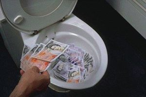 Money thrown down the toilet